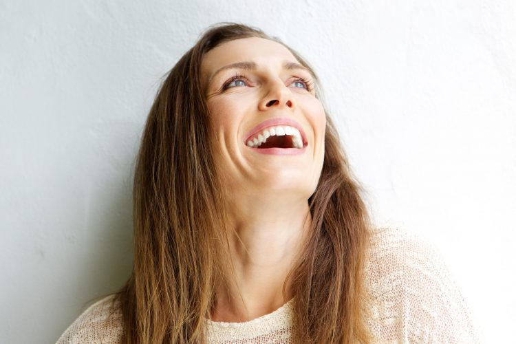 gum graft alternatives at norburn dental centre in burnaby woman smiling and looking up